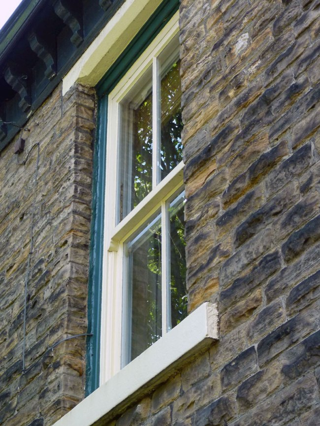 Keeping the original windows in a Victorian house retains the character