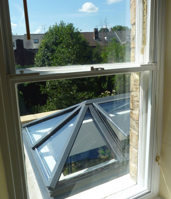 The secondary glazed units sit over the existing primary window frame