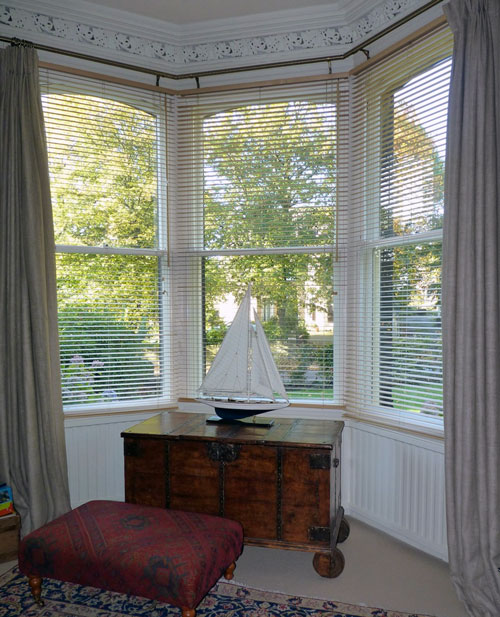 By choosing off-white frames for their secondary glazing, this customer has a discreet solution - and a warmer, quieter room!