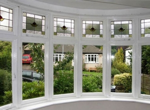 Post secondary glazing installation, this curved bay window is  warmer, quieter and drie