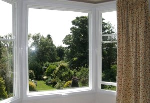 An uninterrupted garden view, and the secondary glazed units open easily for ventilation.