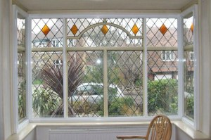 Post secondary-glazing, this period square bay windowed room receives much less traffic noise.